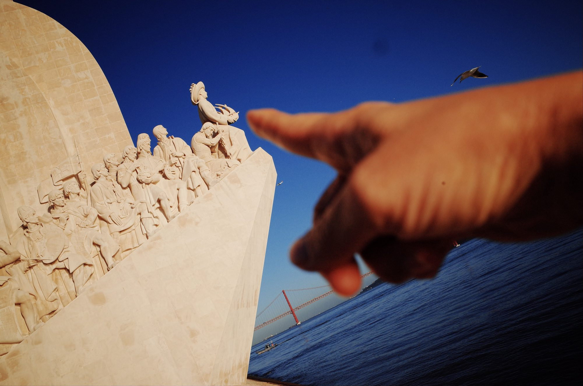 Finger pointing to monument. Lisbon, 2018