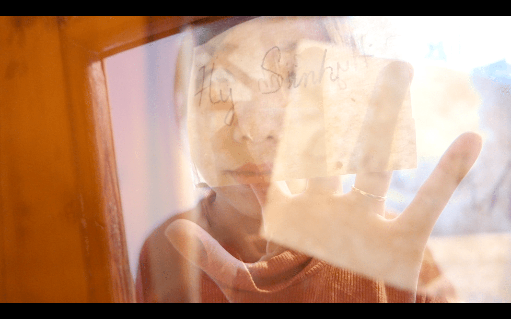"Still from ""The Undeniable Force of Khó Khăn"" Film-- where we focused on the hand with the translucent paper"