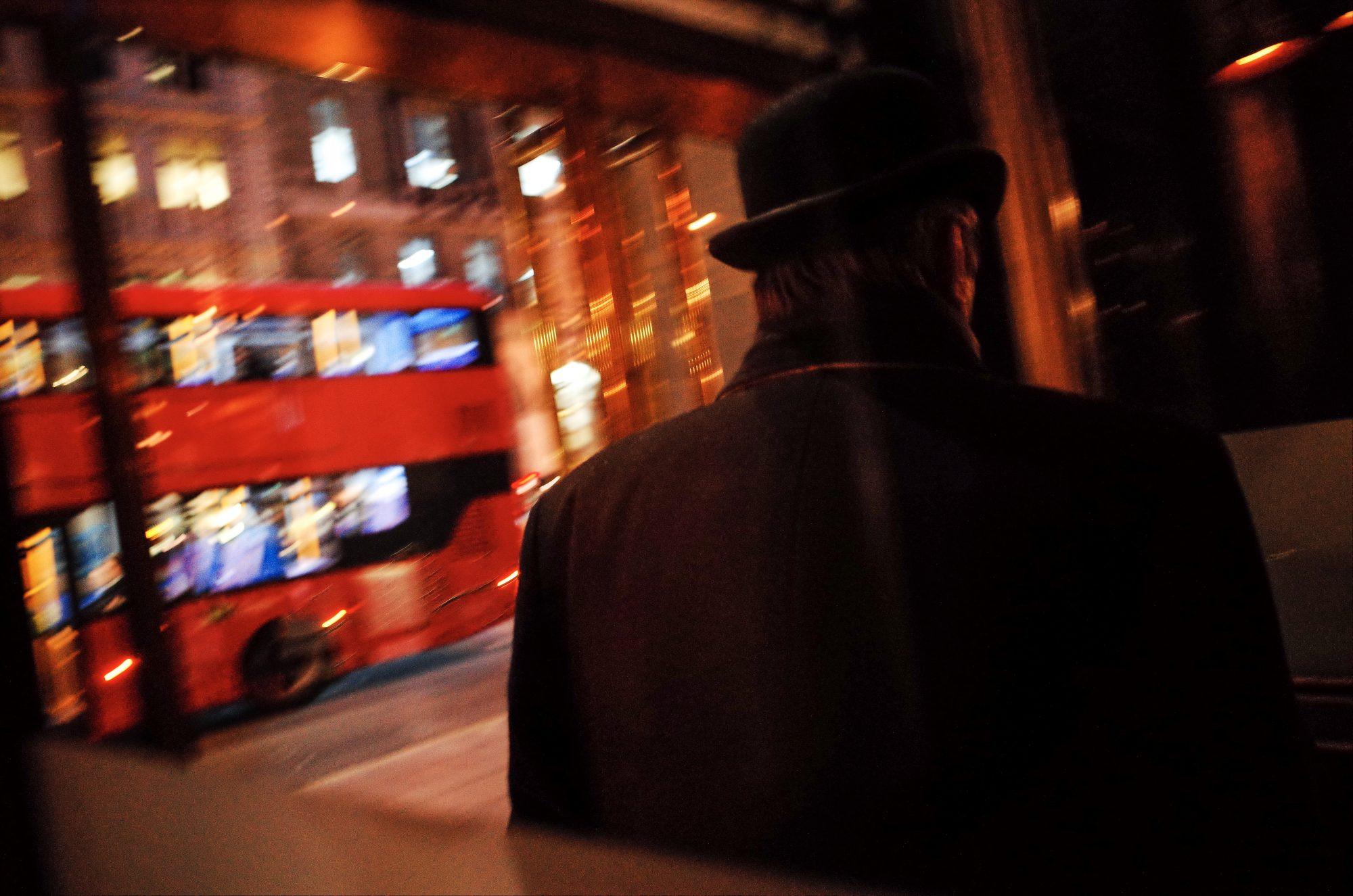 Man in bowler hat. Night street photo, London 2018