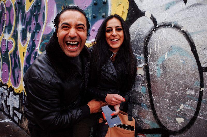 Laughing couple. Brick Lane, London 2018