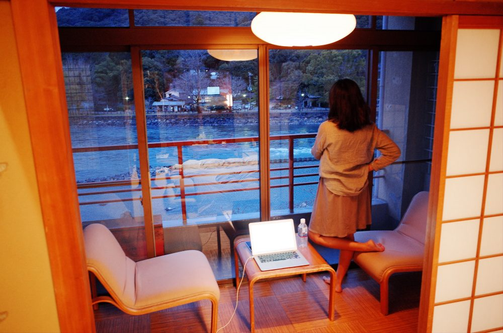 Cindy inside our Ryokan, looking out towards the water.