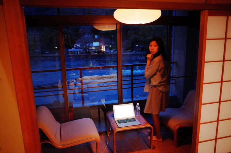Cindy looking at river. Ryokan. Uji, 2018