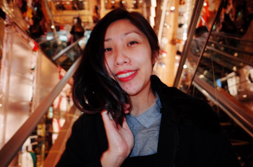 Cindy on escalator. Osaka, 2018