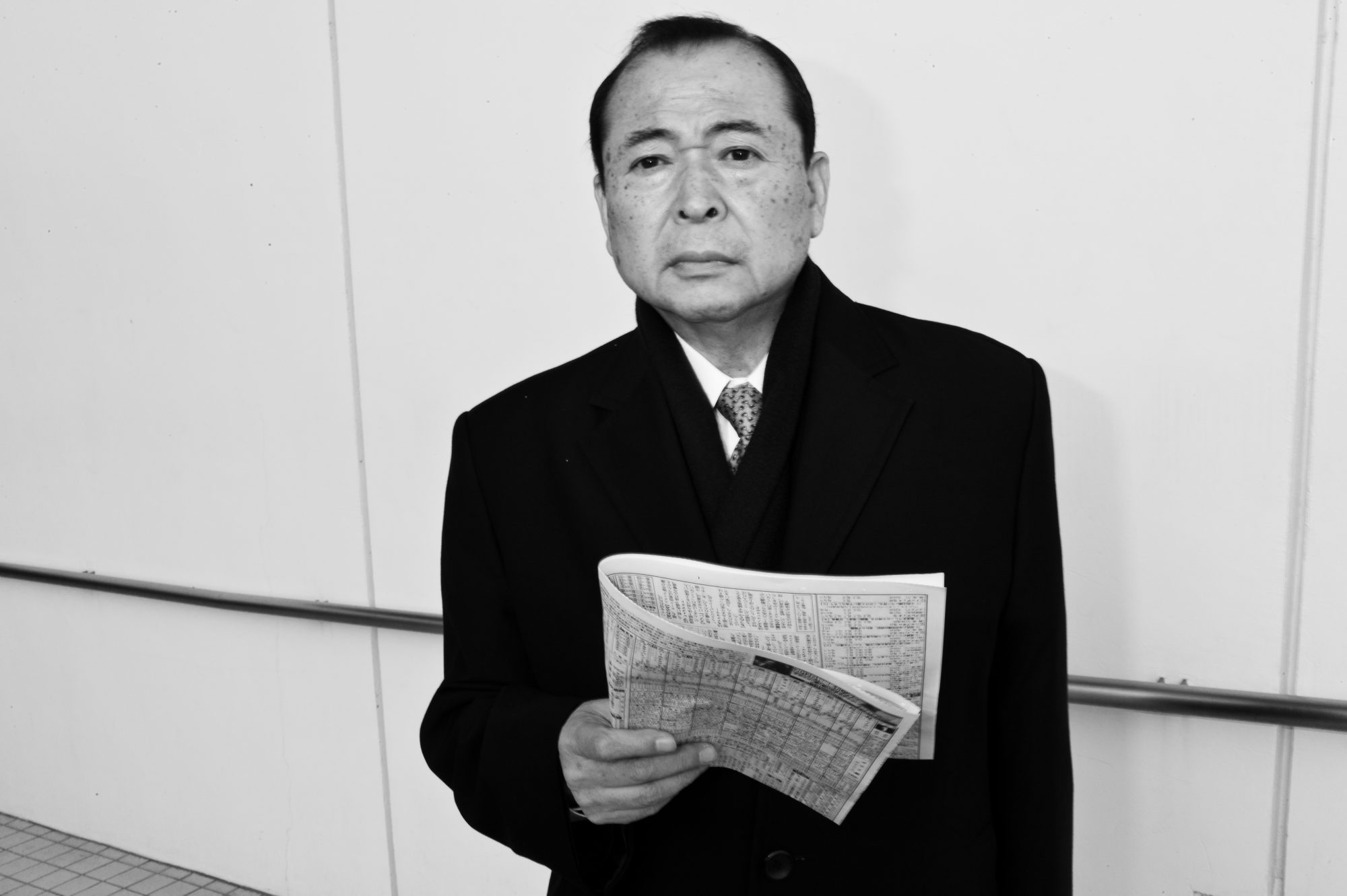 Tokyo race track suit, black and white, newspaper, candid street photography eric kim, Leica m9
