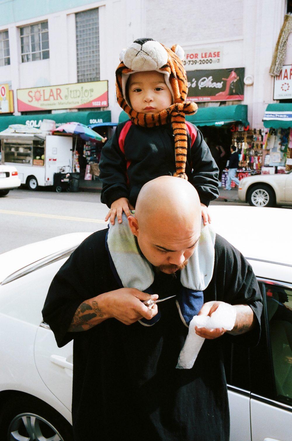 Kid on shoulder of father