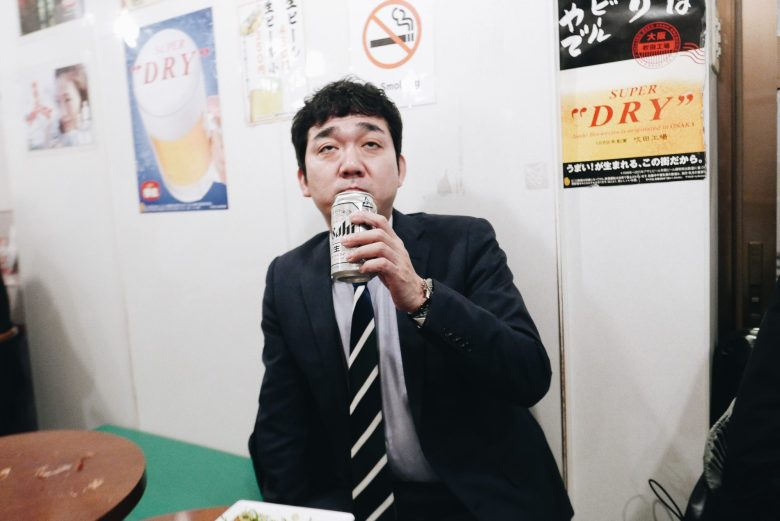 Salary man drinking a beer. Osaka, 2018