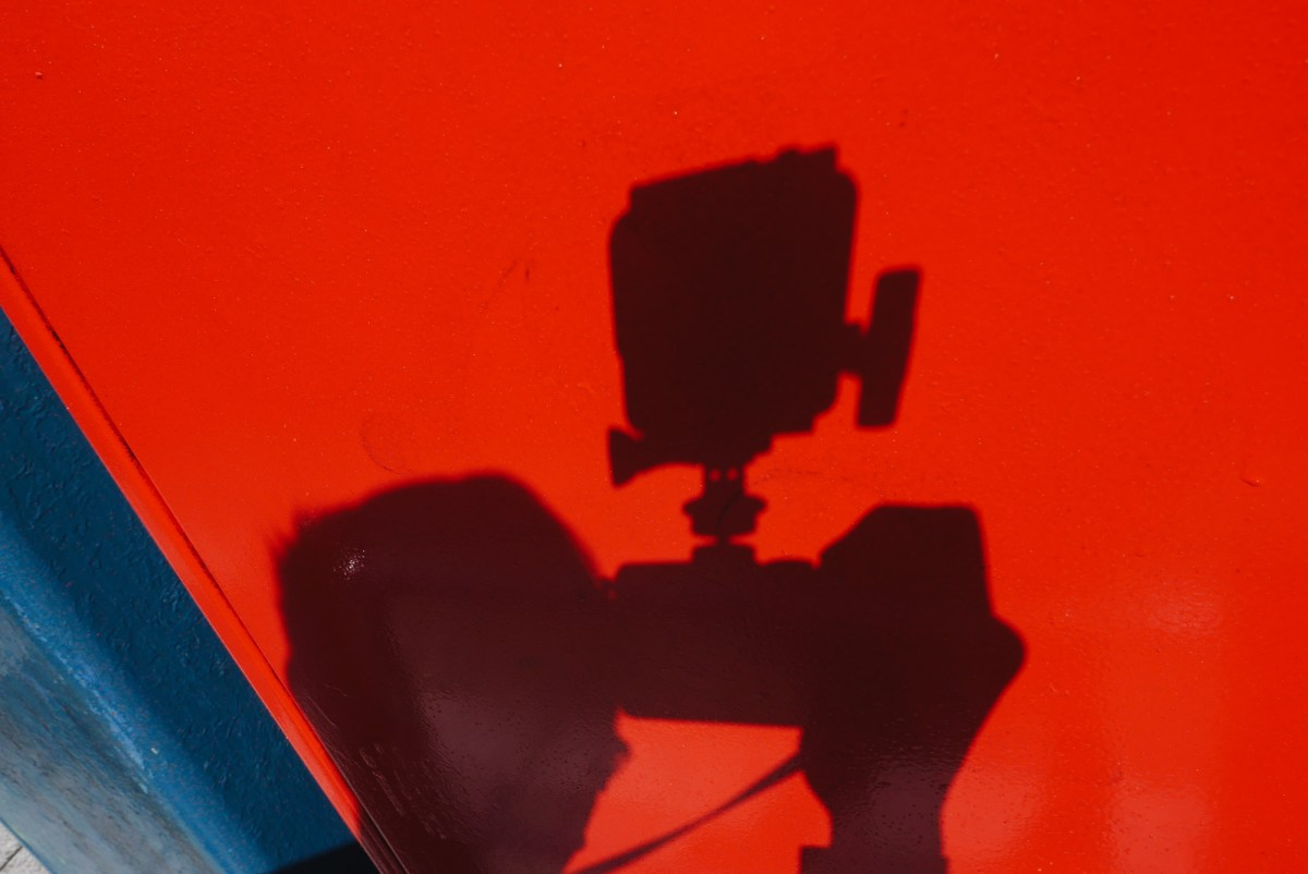 GoPro selfie red and blue background