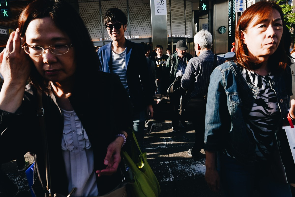 Getting close and filling the frame of the sea of people. At crosswalk in Kyoto Station, 2018