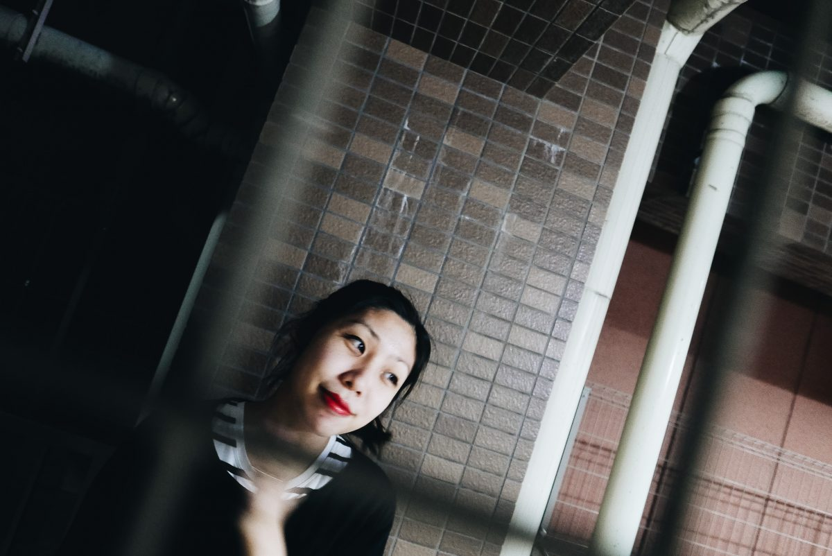 Cindy in front of our apartment. Dutch angle at night. Kyoto, 2018