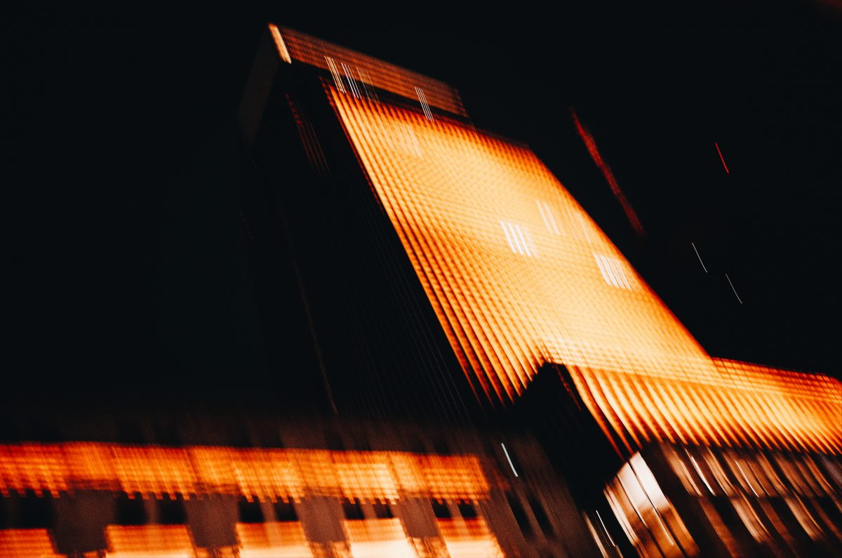 Blurry Tokyo lights building night black orange