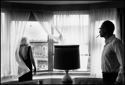"USA. Reno, Nevada. 1960. Set of ""The Misfits"". Marilyn Monroe and Arthur Miller in their suite in Reno's Mapes Hotel after a day's shooting."
