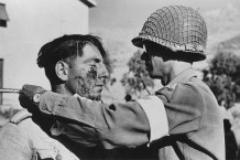 ICP 525. July, 1943. A member of the American Medical Corps treats a German prisoner of war.