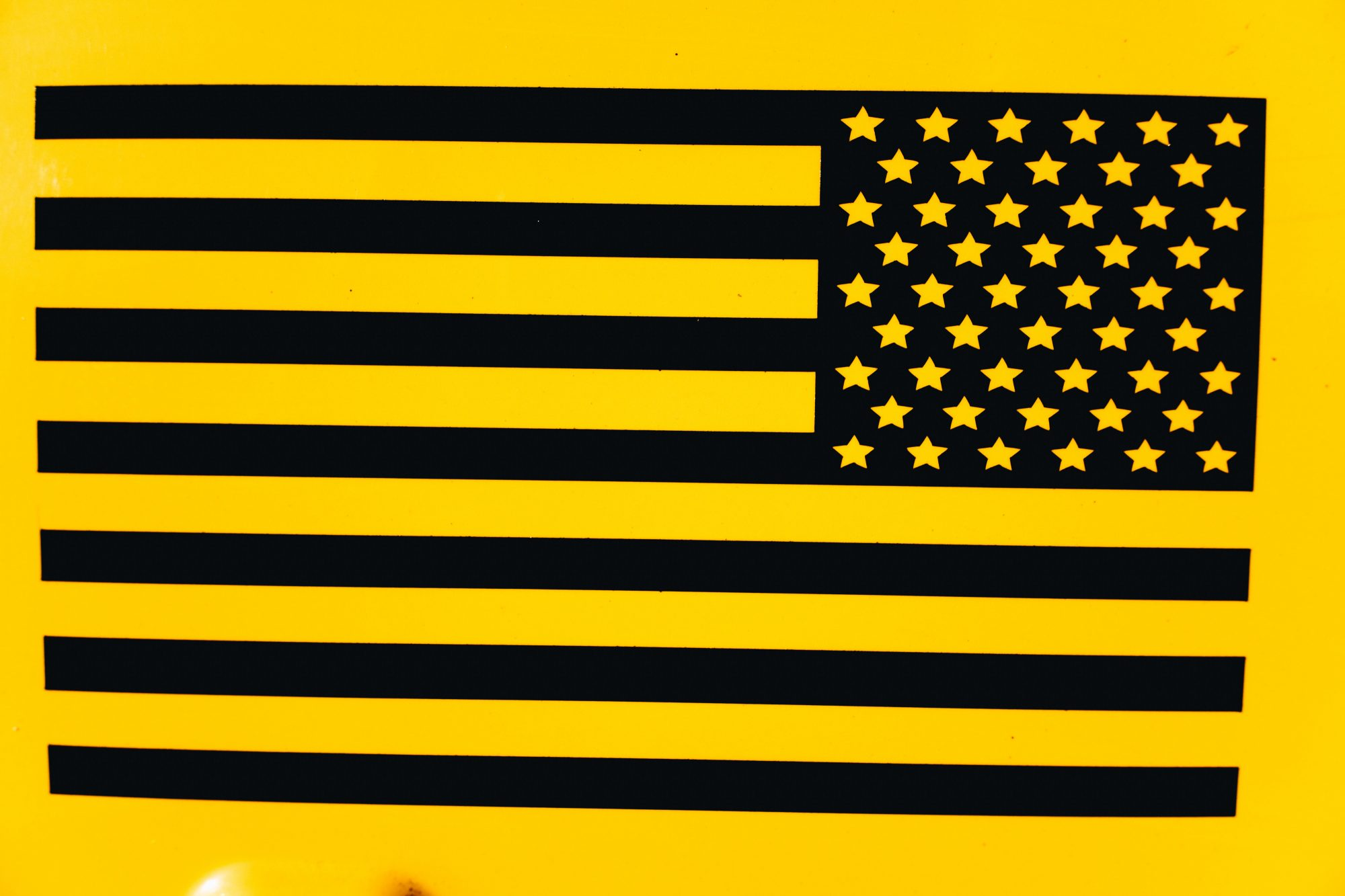 black and yellow American flag