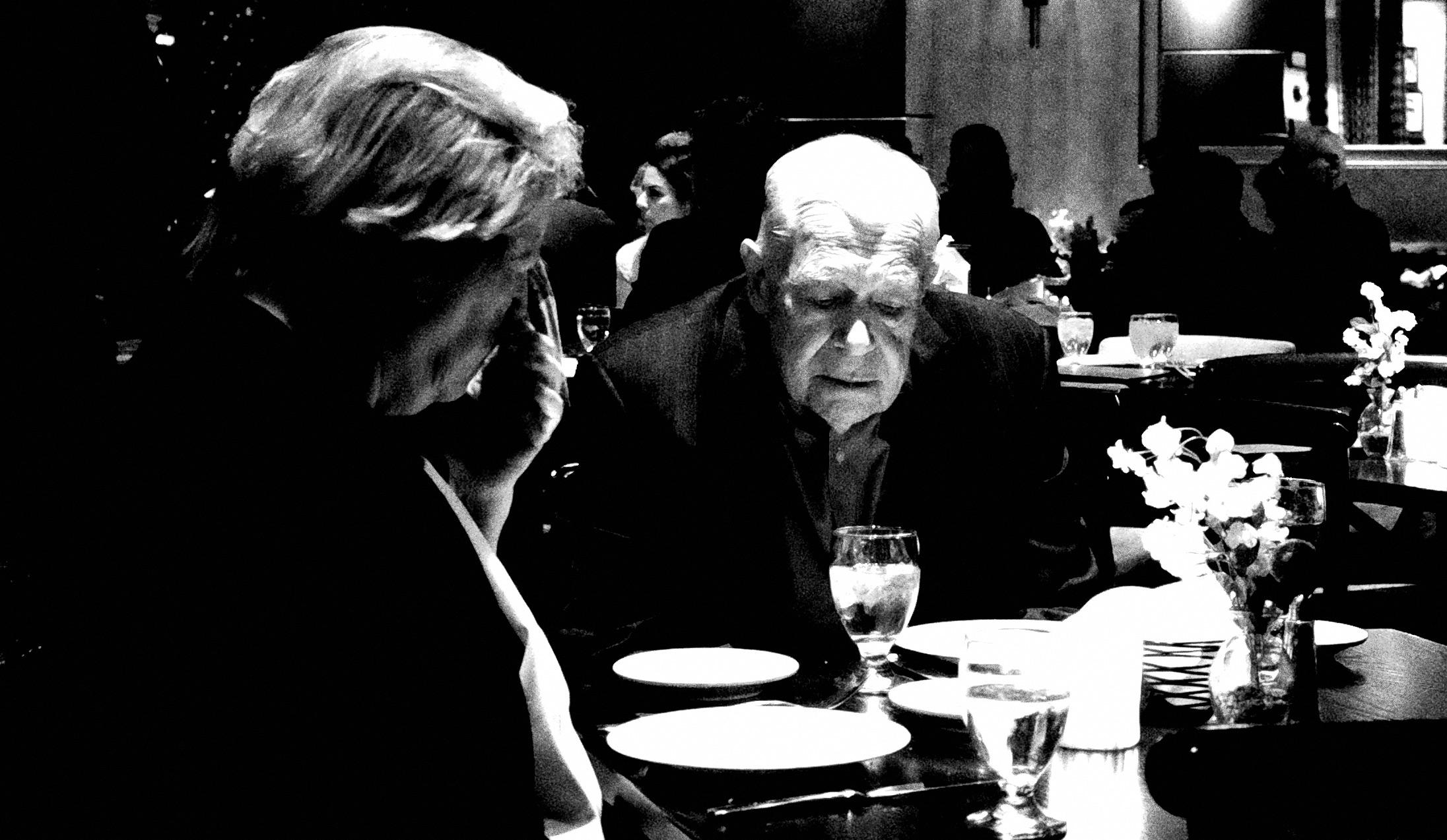 Older couple having dinner at fancy restaurant.