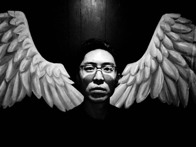 Eric angel wings selfie iPhone pro