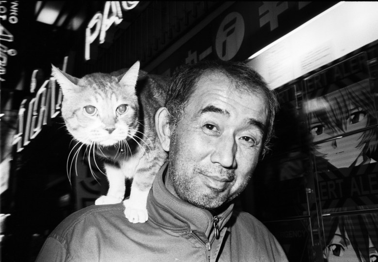 Tokyo flash. Cat on man's shoulder.