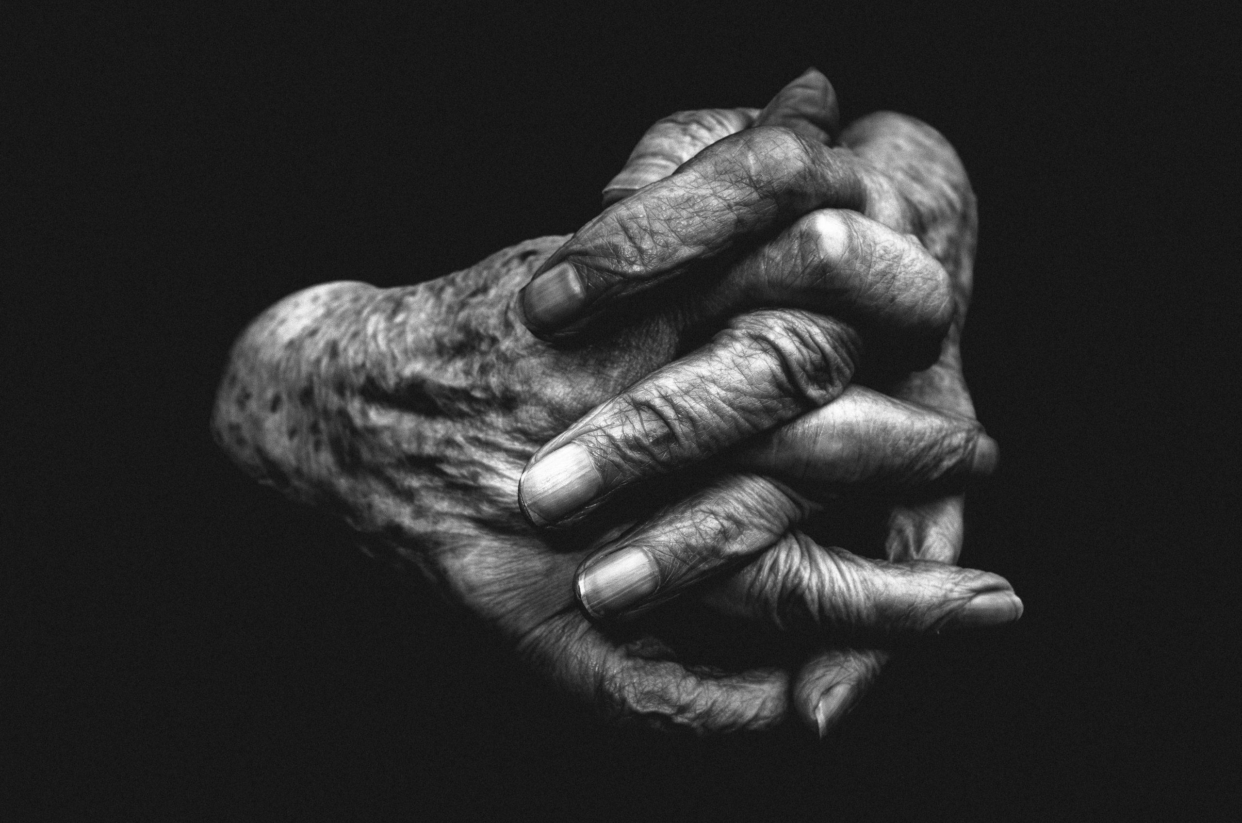 Crossed hands of woman in Paris