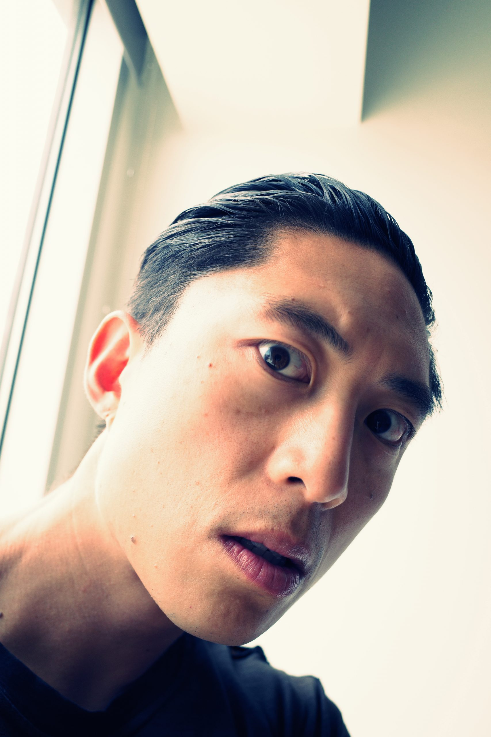 selfie face ERIC KIM side angle