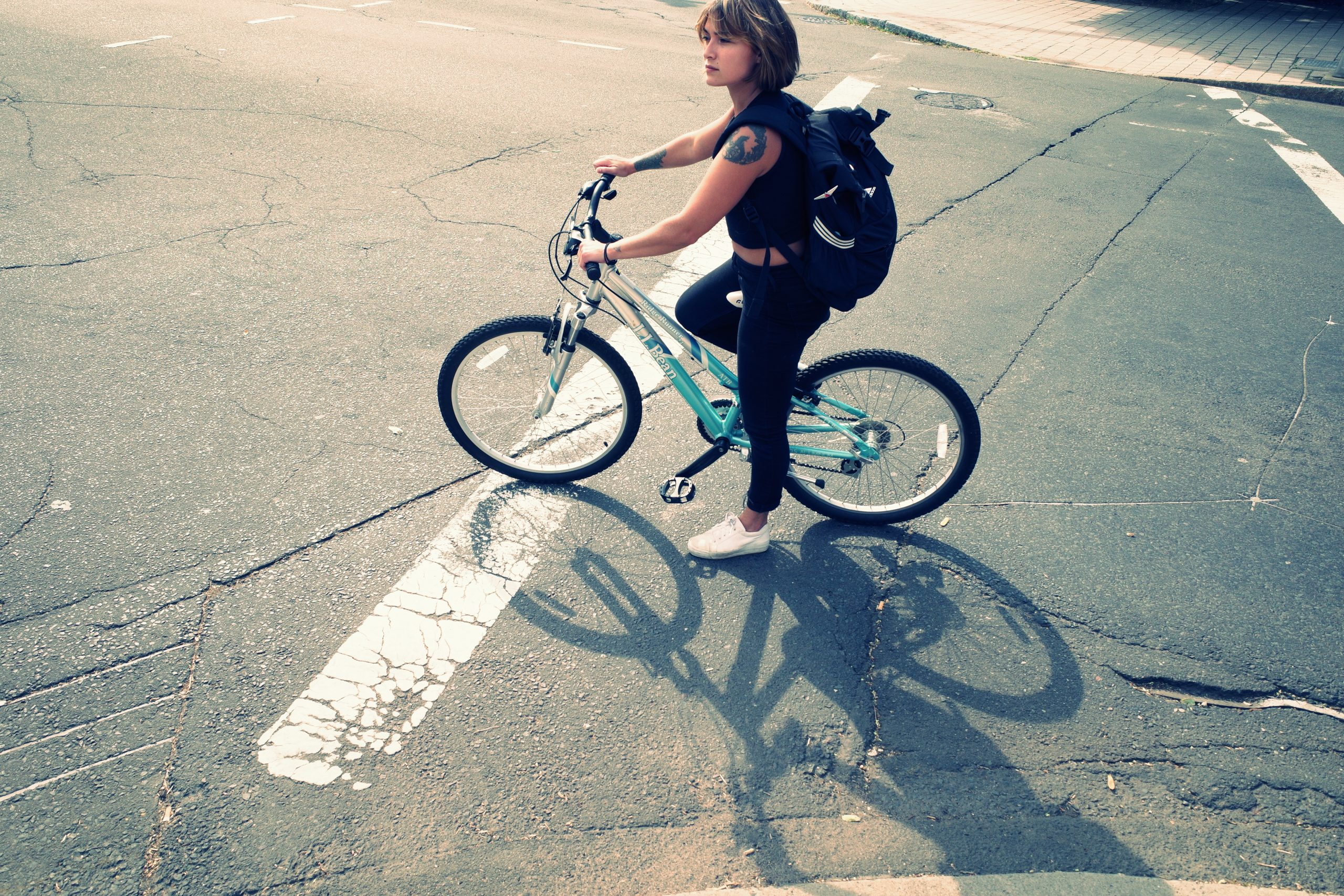 girl bicycle face high angle new haven ERIC KIM street photograph