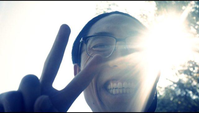 ERIC KIM PEACE SIGN LIGHT SELFIE