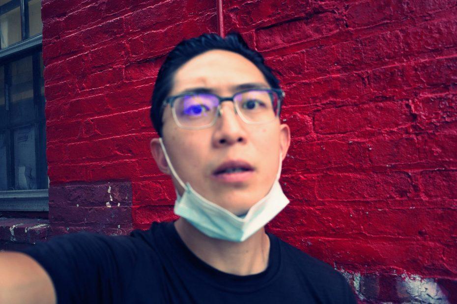 selfie ERIC KIM red wall