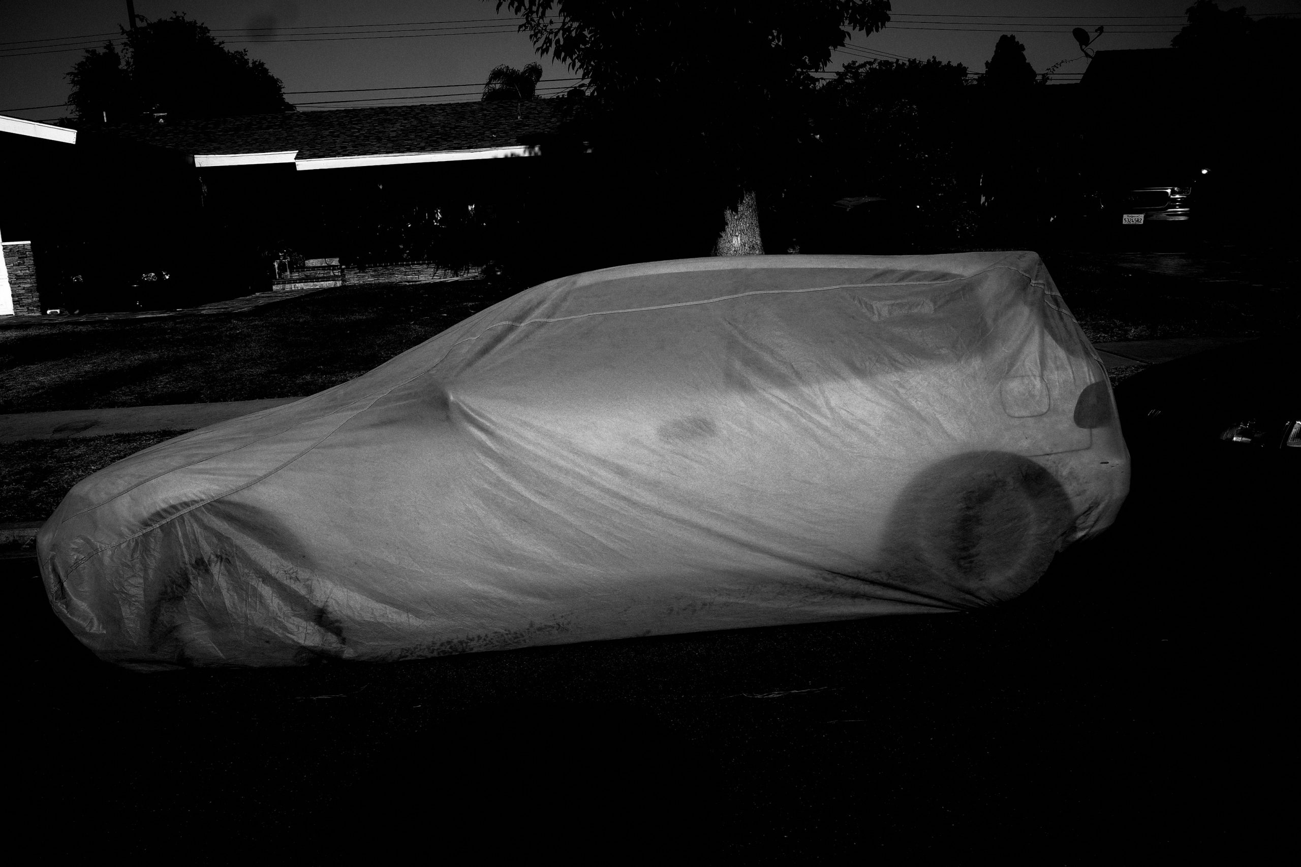 ghost car black and white urban landscape