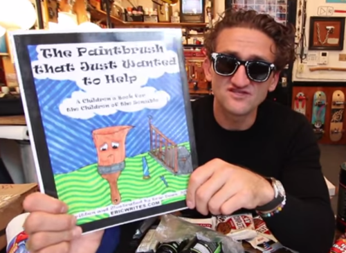 Casey Neistat with a printed copy