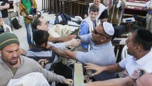 Charlie Kalech suffered injuries to his head after delivering a Torah scroll from the men's section of the Western Wall to the Women of the Wall group, April 20, 2015.