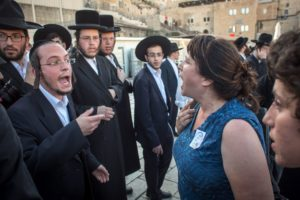 Ultra-Orthodox men argue with Reform worshipers during a mixed prayer service at the Western Wall