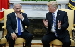 US President Donald Trump (R) meets with Prime Minister Benjamin Netanyahu in the Oval Office of the White House,