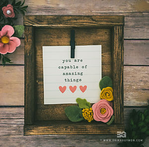 "Framed quote ""You Are Capable Of Amazing Things"" decorated with felt flowers"
