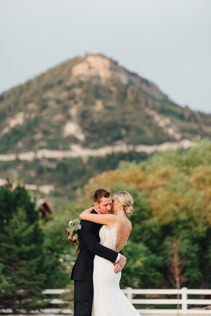 bride and groom at crooked willow farms in larkspur, colorado