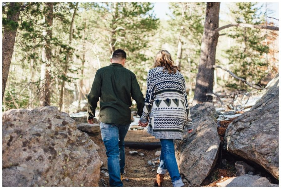 Couple hiking through Rocky Mountain National Park