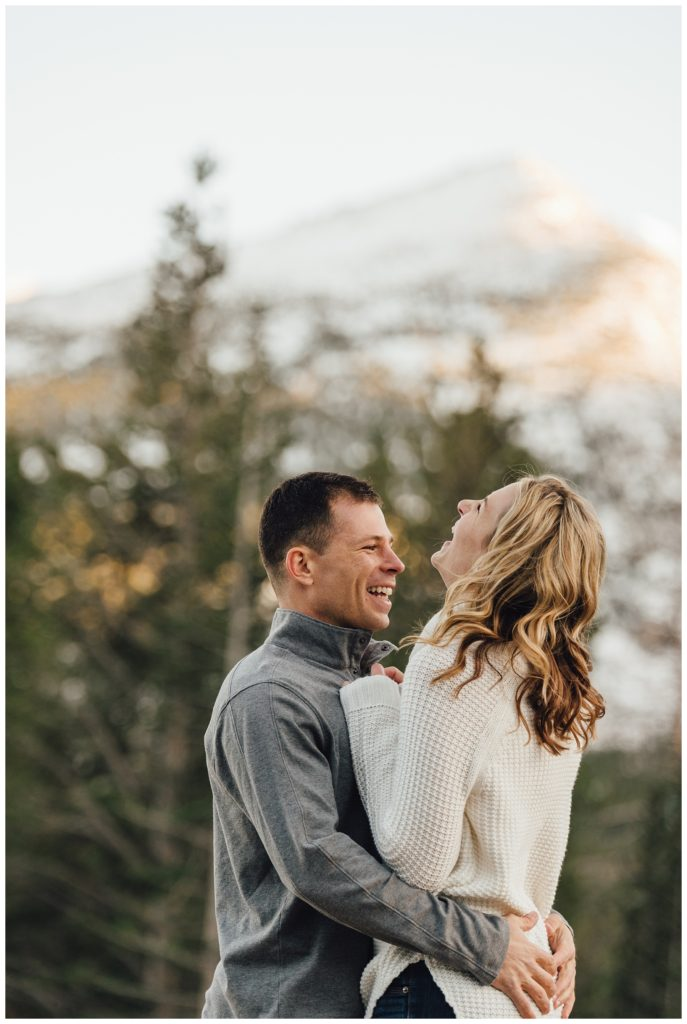 Authentic laughing engagement photos in Rocky Mountain National Park