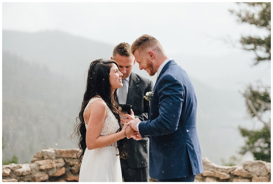Bride and groom laugh together during their wedding ceremony at Sapphire Point