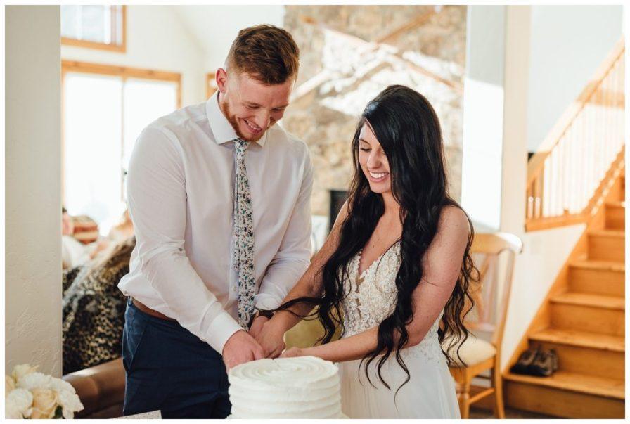Bride and groom cut their wedding cake