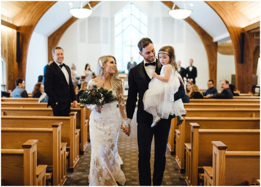 Bride and groom exit with their daughter