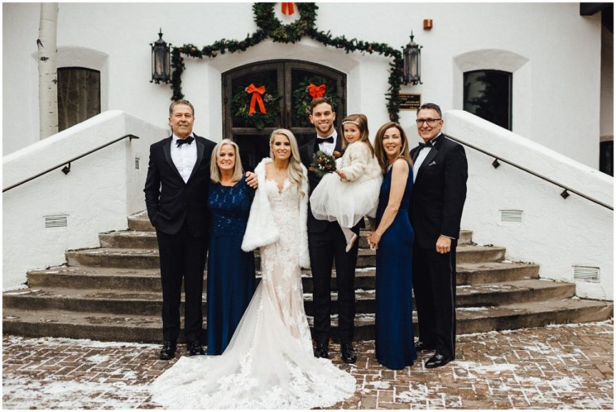 Bride and groom with their parents in front of the Vail Interfaith Chapel in Vail Colorado