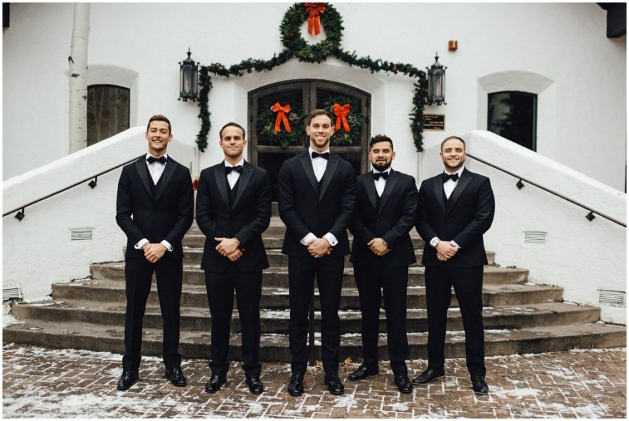 Groom with his groomsmen in front of the Vail Interfaith Chapel in Vail Colorado
