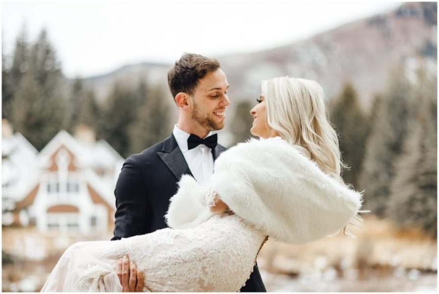 Groom holding his bride at their snowy winter elopement in the Colorado Rockies