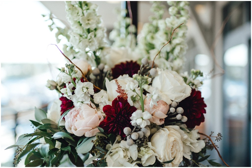 Gorgeous winter floral bouquet by Kayle Walker Burns at Petal and Bean Floral and Event Planning.