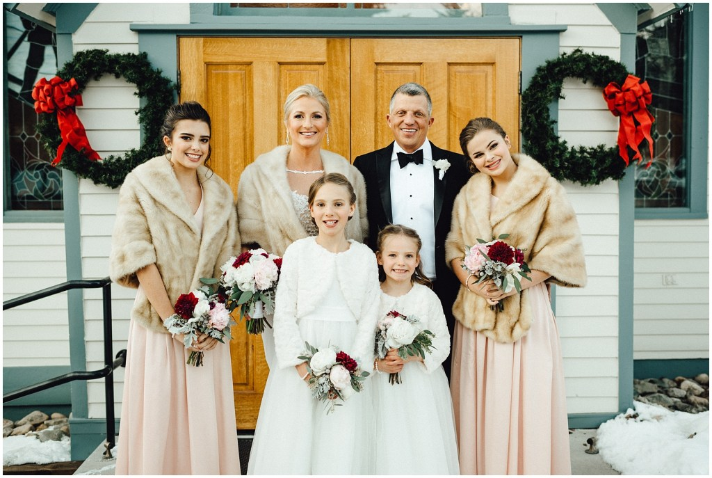 The bride and groom with their bridal party at this beautiful Breckenridge winter wedding.