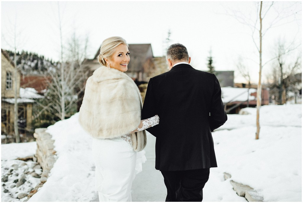 Bride looks so proud to be his wife at this mountain winter wedding in Breckenridge.