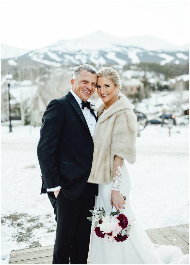 Breckenridge winter wedding in front of those gorgeous Colorado mountains.
