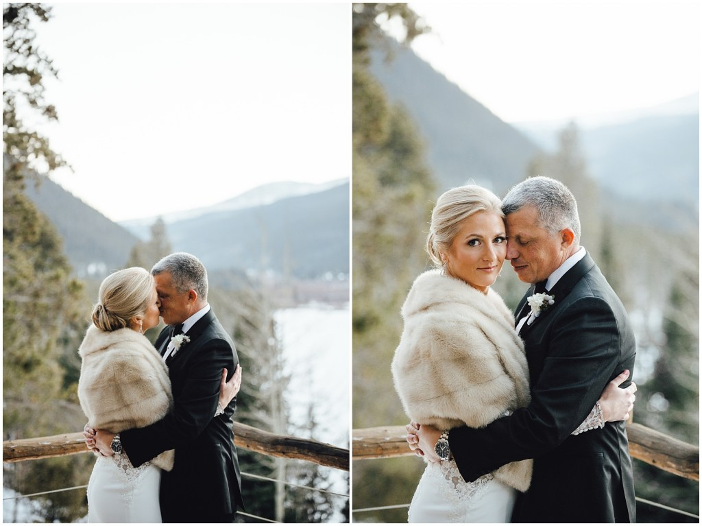 Bride and groom embrace in front of these Colorado mountains at this Breckenridge winter wedding.