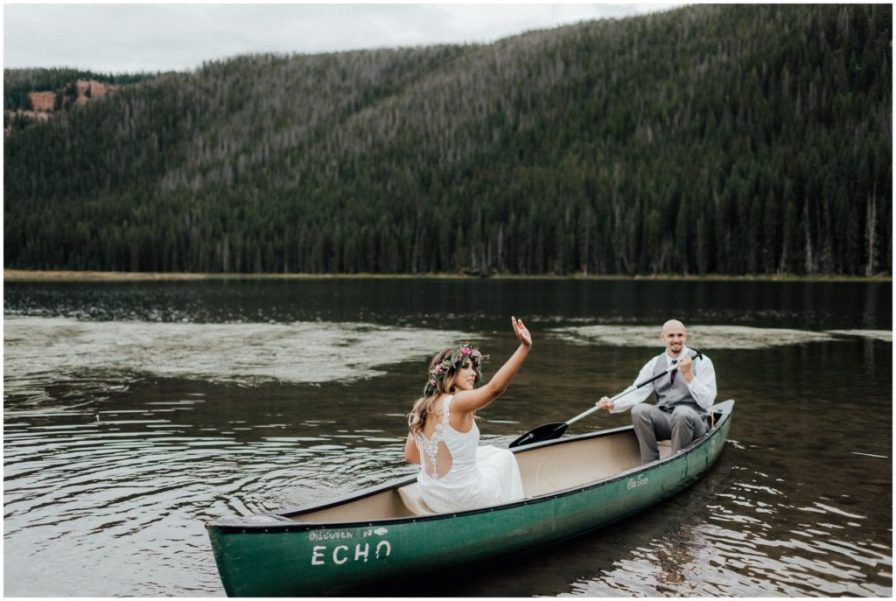 bride and groom wave to family on shore