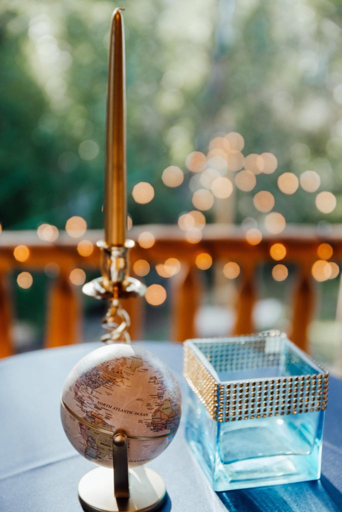 mini globes on cocktail tables