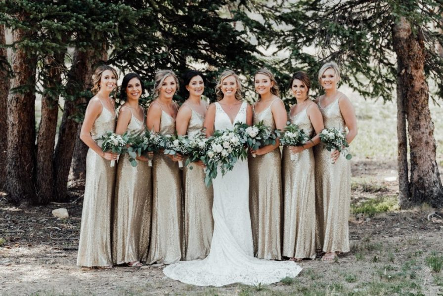 Gold sequin bridesmaid dresses, eucalyptus greenery bouquets
