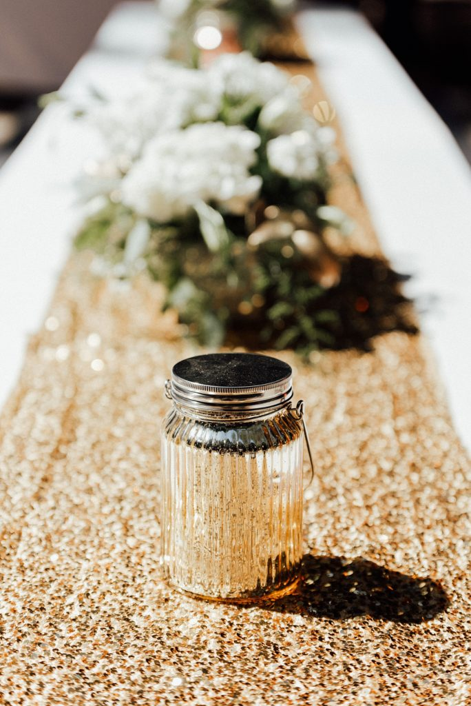 Gold sequin table runners, glam camping wedding