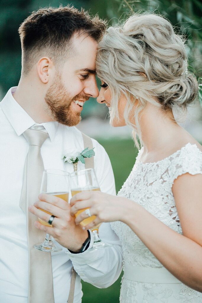 Couple enjoying a beer on their wedding day